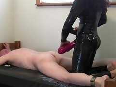 Femdom big red-hot dildo strapon latex catsuit