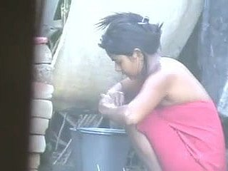 wow... staggering desi townsperson belle rinsing outside