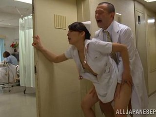 Horny nurse's fucked by a doctor in a clinic hallway